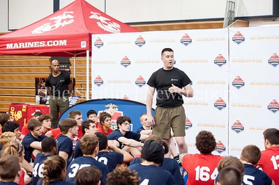 4/1/2017 - Sgt. Cameron McNeill from the Recruiting Substation in Rockville (RSS) speaks to the athletes at the USMC Sports Leadership Academy Wrestling Clinic at Magruder High School, ©2017 Jacqui South Photography