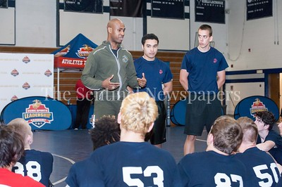 4/1/2017 - Staff Sgt. Naquan Peterson talks with a group of wrestlers during the USMC Sports Leadership Academy Wrestling Clinic at Magruder High School, ©2017 Jacqui South Photography