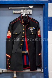 4/1/2017 - Sgt. Cameron McNeill's uniform hung at the USMC Sports Leadership Academy Wrestling Clinic, ©2017 Jacqui South Photography