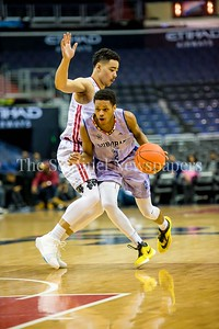 4/8/2017 - Trent Dixon (Central High School) guarded by Emanuel Hylton (St. John's) in the District v Suburban All-Star Capital Classic game, ©2017 Jacqui South Photography