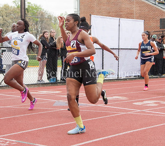 Bullis, Taylor Johnson, MacNamara Taylor Marshall, 1 and 2 in their heat in the 100 Meter dash, also in shot, Holton Arms Taylor Simpson