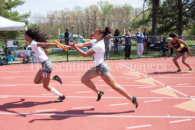 Bullis Leah Phillips takes the baton from Lauryn Harris