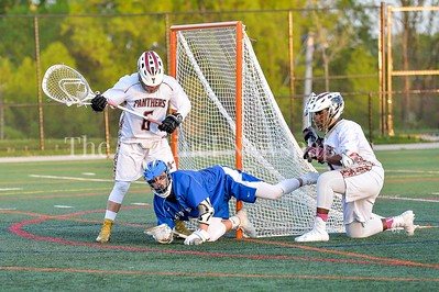 4/18/2017 - Sherwood attack Nick Gallagher (11) lands inside the crease with Paint Branch goalie Sergio Orellana (6), ©2017 Jacqui South Photography