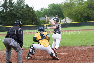 Poolesville Zach Widenhofer (12) gets a base hit. Spencer Sampson (18) Catcher