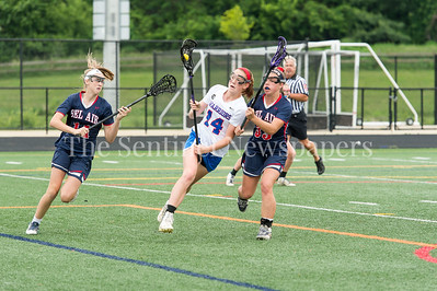 5/20/2017 - Sherwood middie Abbey Rose (14) carries the ball double-teamed by Bel Air defenders Maggie Hall (11) & Taylor Patrick (33) in the Bel Air v Sherwood Girls 3A/4A Regional Championship Lacrosse Game, ©2017 Jacqui South Photography