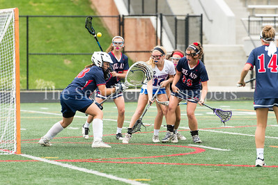 5/20/2017 - Bel Air goalie Bailey Springer (43) along with defenders Sam Stachowiak (2), Jay Harden (25) & Taylor Patrick  (33) try to keep Sherwood attack Katie Cunius (16) from the ball in the Bel Air  v Sherwood Girls 3A/4A Regional Championship Lacrosse Game, ©2017 Jacqui South Photography