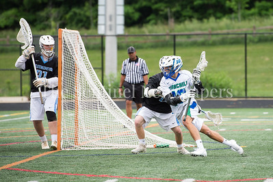 5/20/2017 - Churchill attack Ryan Shure (10) zips around the goal looking to score  in the 4A/3A Regional Championship lacrosse game at Gaithersburg High School, ©2017 Jacqui South Photography
