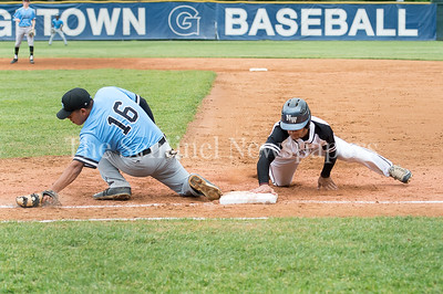 5/23/2017 - Roosevelt 1st baseman Kevin Reyes (16) stretches to make the catch as Jordan Qassis (37) touches 1st base in the 4A Regional Championship game at Shirley Povic Field,  ©2017 Jacqui South Photography
