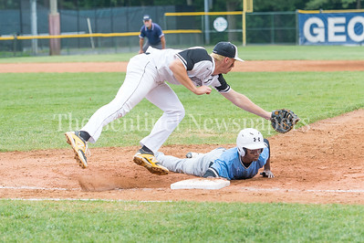 5/23/2017 - SeVon Anthony (13) slides safely to first as 1st baseman Michael Yuille (28) reaches around for the catch in the 4A Regional Championship game at Shirley Povic Field,  ©2017 Jacqui South Photography