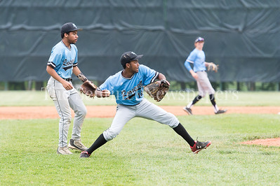 5/23/2017 - Roosevelt starting pitcher Devin Robinson (18) makes a throw to 1st, but not in time as Northwest batter Josh Netteville gets an infield single in the 4A Regional Championship game at Shirley Povic Field,  ©2017 Jacqui South Photography
