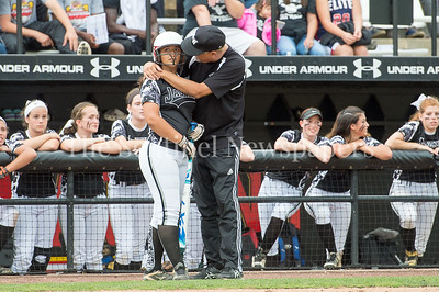 5/27/2017 - Northwest Coch Mike Horton and 1st baseman Kaylah Qassis strategize during the Maryland 4A championship softball game, ©2017 Jacqui South Photography