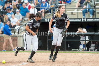 5/27/2017 - Northwest 1st baseman Kaylh Qassis (left) and pitcher Amber Yuille (right)  Sherwood v Northwest Softball, ©2017 Jacqui South Photography