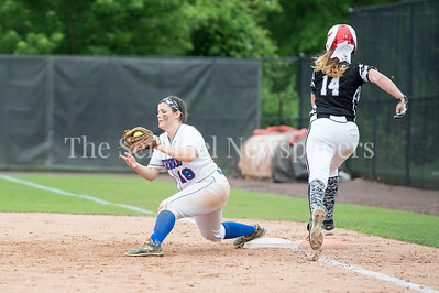 5/27/2017 - Sherwood 1st baseman Faith Hanrahan makes the catch to put out Amber Yuille to end the 3rd inning during the Maryland 4A championship softball game, ©2017 Jacqui South Photography