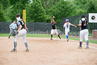 5/27/2017 - Sherwood shortstop Hannah St. Laurent thrown on on a bunt from Megan Ridenour (3B) to Kaylah Qassis (1B) in the Maryland 4A championship softball game, ©2017 Jacqui South Photography