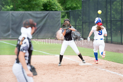 5/27/2017 - Top of the 7th inning Madison Wessling is safe on a bunt to 1st baseman Kaylah Qassis during the Maryland 4A championship softball game, ©2017 Jacqui South Photography