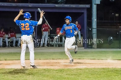 6/9/2017 - Tyler Galazin (22) signals teammate Brandon Crosby (9) no need to slide as Crosby scores in the 7th inning for the Express, ©2017 Jacqui South Photography