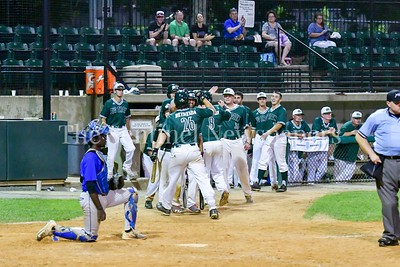 6/15/2017 - James Outman (26) getting some high fives after hitting a 2-run homerun in the 9th inning, Bethesda Big Train, ©2017 Jacqui South Photography