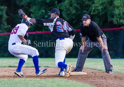Thunderbolt's Alex Yi-Chen-Jou (39) tagged out at first base by D McFadden (24). 06 23 2017  Rockville Express v Takoma Park Silver Spring Thunderbolts Baseball