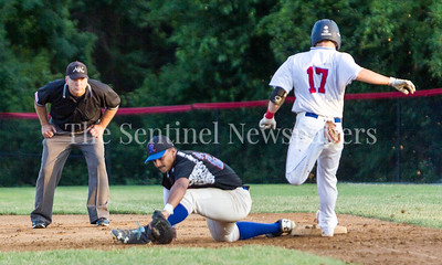 Express D McFadden (24) goes into the splits to get Tommy Gardiner (17) out. 06 23 2017  Rockville Express v Takoma Park Silver Spring Thunderbolts Baseball