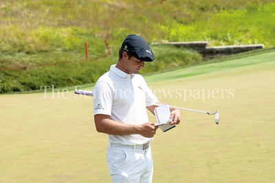 Bryson DeChambeau reviews his scoring book after putting out at the 14th. 06 29 2017 Quicken Loans National Golf Tournament at TPC Potomac Day 3 Thursday