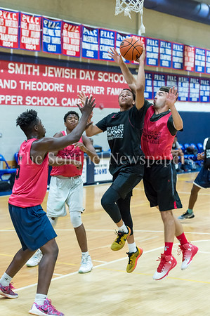 7/18/2017 - Springbrook's Michael Germaine gets fouled by Einstein's Joey Curtin on this layup, Maryland Elite Summer Basketball, ©2017 Jacqui South Photography