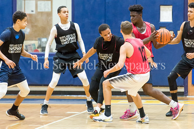 7/18/2017 - Caleb Arthur keeps the ball out of reach from Michael Germaine, Maryland Elite Summer Basketball, ©2017 Jacqui South Photography