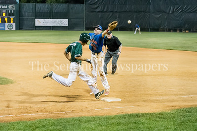7/20/2017 - In the bottom of the 8th inning, Jacob Koos looks safe at 1st, runs to 2nd base on the overthrow, only to be called out for interference, which set off manager Sal Colangelo, who was ejected from the game, Thunderbolts v Big Train, Photo Credit: Jacqui South