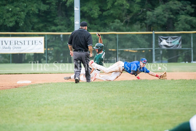 7/20/2017 - In the 3rd inning Vinny Esposito safely slides to 2nd base as the ball bounces over Tommy Gardiner's glove on an error throw from the catcher, Thunderbolts v Big Train, Photo Credit: Jacqui South