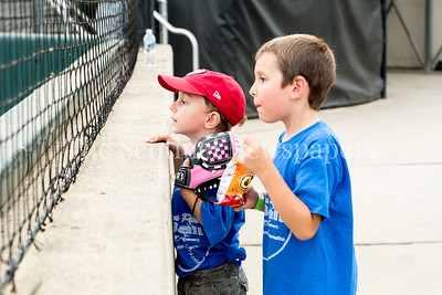 7/21/2017 - A couple of young fans enjoy the close up view behind home plate during the Riverdogs v Thunderbolts game, Photo Credit: Jacqui South