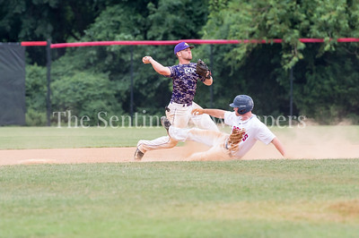 7/21/2017 - Michael Fitzsimmons slides towards shortstop Clayton Baine to break up a double-play in the 2nd inning, Photo Credit: Jacqui South