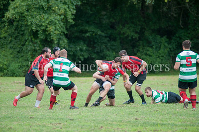 Potomac Exile Will Tylor (In red w/ball) gets tackled. 08 26 2017 Potomac Exile v Lancaster Roses Rugby