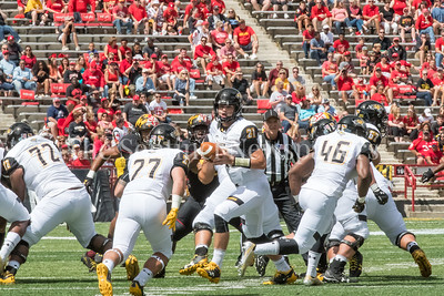 9/9/2017 - Ryan Stover (2) looks to hand off to Adrian Platt (27), Towson v University of Maryland Football, Photo Credit: Jacqui South