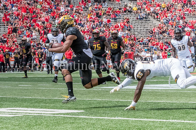 9/9/2017 - D.J. Moore (1) evades a tackle from Diondre Wallace (56) on his way to scoring a touchdown for the Terps, Towson v University of Maryland Football, Photo Credit: Jacqui South