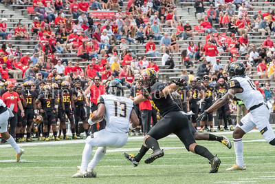 9/9/2017 - Shane Cockerille (18) readies to tackle Shane Simpson (13), Towson v University of Maryland Football, Photo Credit: Jacqui South