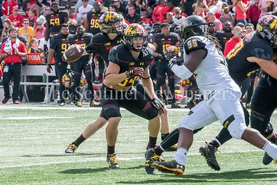 9/9/2017 - Jake Funk (34) looks to block Towson Kanyia Anderson (99), Towson v University of Maryland Football, Photo Credit: Jacqui South