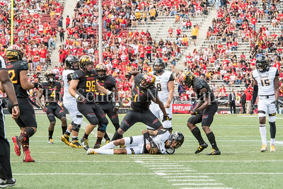 9/9/2017 - Jermaine Carter Jr. (10 reacts to tacklig Jabari Greenwood (7), Towson v University of Maryland Football, Photo Credit: Jacqui South