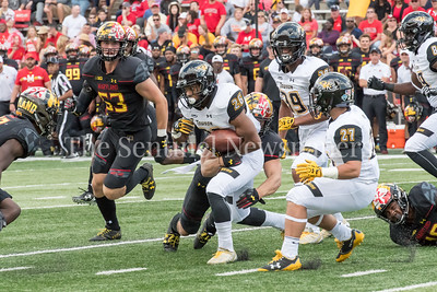 9/9/2017 - Terp linebacker Shane Cockerille (18) brings down Towson receiver Rodney Dorsey (26), Towson v University of Maryland Football, Photo Credit: Jacqui South