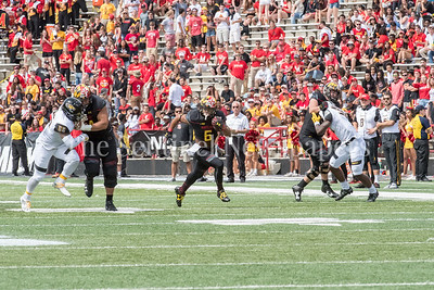 9/9/2017 - Ty Johnson gets blocks from Brendan Moore (64) and Sean Christie (70) clearing the way to score a touchdown,  Towson v University of Maryland Football, Photo Credit: Jacqui South