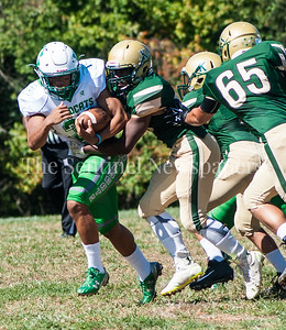 Walter Johnson High School Wildcats Andrew Barnes (3) breaks out of a tackle. 09 23 2017 John F Kennedy High School hosts Walter Johnson High School in Football.