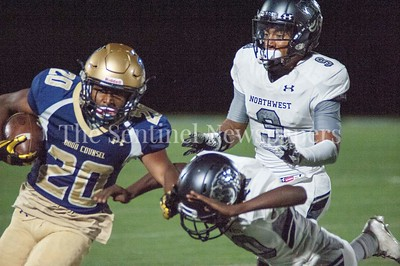 Our Lady of Good Council Falcons Tyler Baylor (20) getting around Brandon Walker (10) and AJ Woods (9). 09 28 2017 Northwest High School at Our Lady of Good Council High School Football