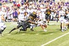 10/14/2017 - Nortwestern running back Justin Jackson (21) dives for a few more yards as Darnell Savage, Jr. (4) and Cavon Walker (5) close in for the tackle, Northwestern v Maryland Football, Photo Credit: Jacqui South