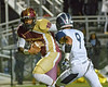 Paint Branch tight end Jordan Griffin gets across the goal line for a touchdown just as Howard's defensive back catches up to him.    Photo by David Wolfe