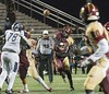 Norman Douglas Jr, QB for Paint Branch throws a dart downfield to wide receiver Max Davis who caught the ball and carried it for a touchdown.<br /> Photo by David Wolfe