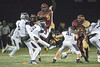 Paint Branch middle linebacker Shawn Harris goes high in an attempt to block a Howard field goal.<br /> Photo by David Wolfe