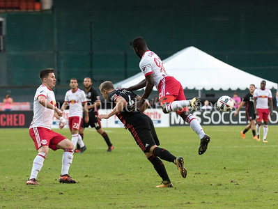 Well after the ball had been redirected, DC United's  Russell Canouse gets flattened from behind by Red Bulls  defender Kemar Lawrence.  DC United vs NY Red Bulls  10-22-17 Photo by David Wolfe