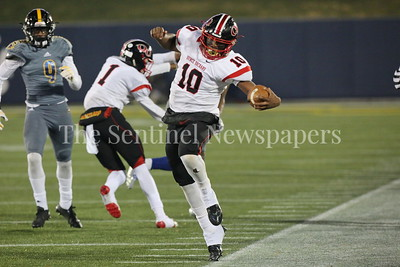 George P. Smith/For The Sentinel    Quince Ochard High School's Doc Bonner (#10) tip toes along the side line for extra yardage.