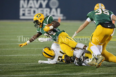 George P. Smith/The Montgomery Sentinel    Damascus High School's Jordan Funk T.D. Ayo-Durojaiye (#34) carries the ball against Gwynn Park High School in the State 2A Final game played at Navy-Marine Corps Memorial Stadium in Annapolis on Saturday, December 2, 2017.