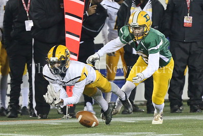 George P. Smith/The Montgomery Sentinel    Damascus High School's Michael Rice covers Gwynn Park High School's Dash Grant (#1) who can't dig this low pass out of the turf in the State 2A Final game played at Navy-Marine Corps Memorial Stadium in Annapolis on Saturday, December 2, 2017.