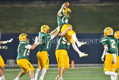 Outside linebacker Timothy Furgeson gets hoisted on the shoulder of  defensive tackle Michael Jurgens to celebrate  Furgeson's steal of the ball from Gwynn Park.  Damascus vs. Gwynn Park 2A State Championships Photo Credit:  David Wolfe