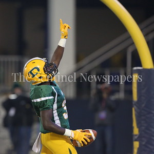 George P. Smith/The Montgomery Sentinel    Damascus High School's T.D. Ayo-Durojaiye (#34) points skyward after scoring a touchdown against Gwynn Park High School in the State 2A Final game played at Navy-Marine Corps Memorial Stadium in Annapolis on Saturday, December 2, 2017.